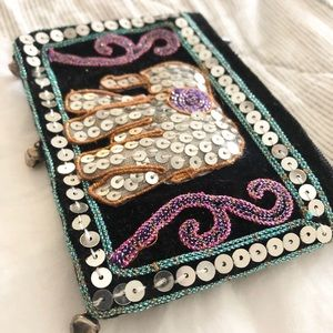 Sequined zipper pouch